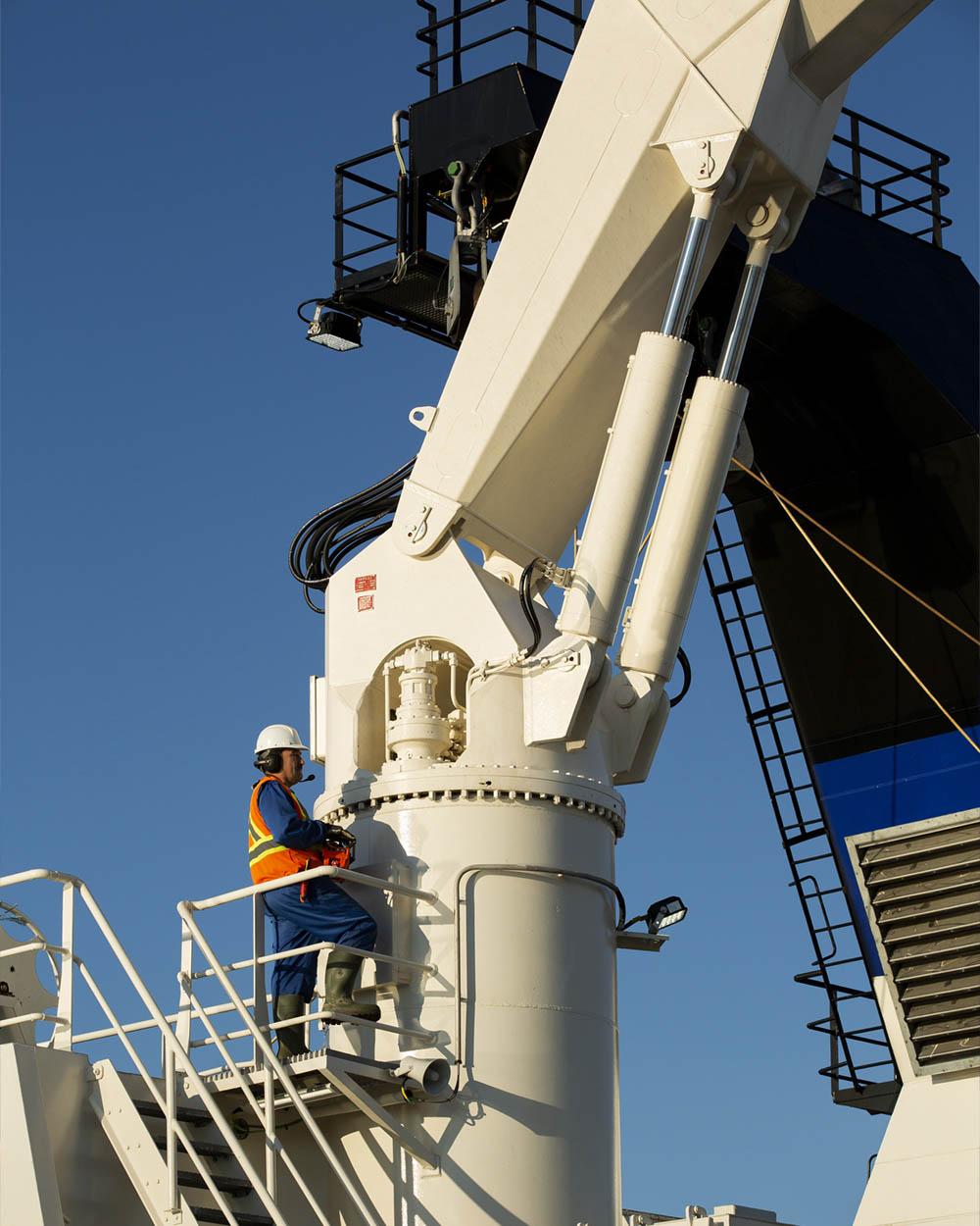 Norther Osprey man working on crane