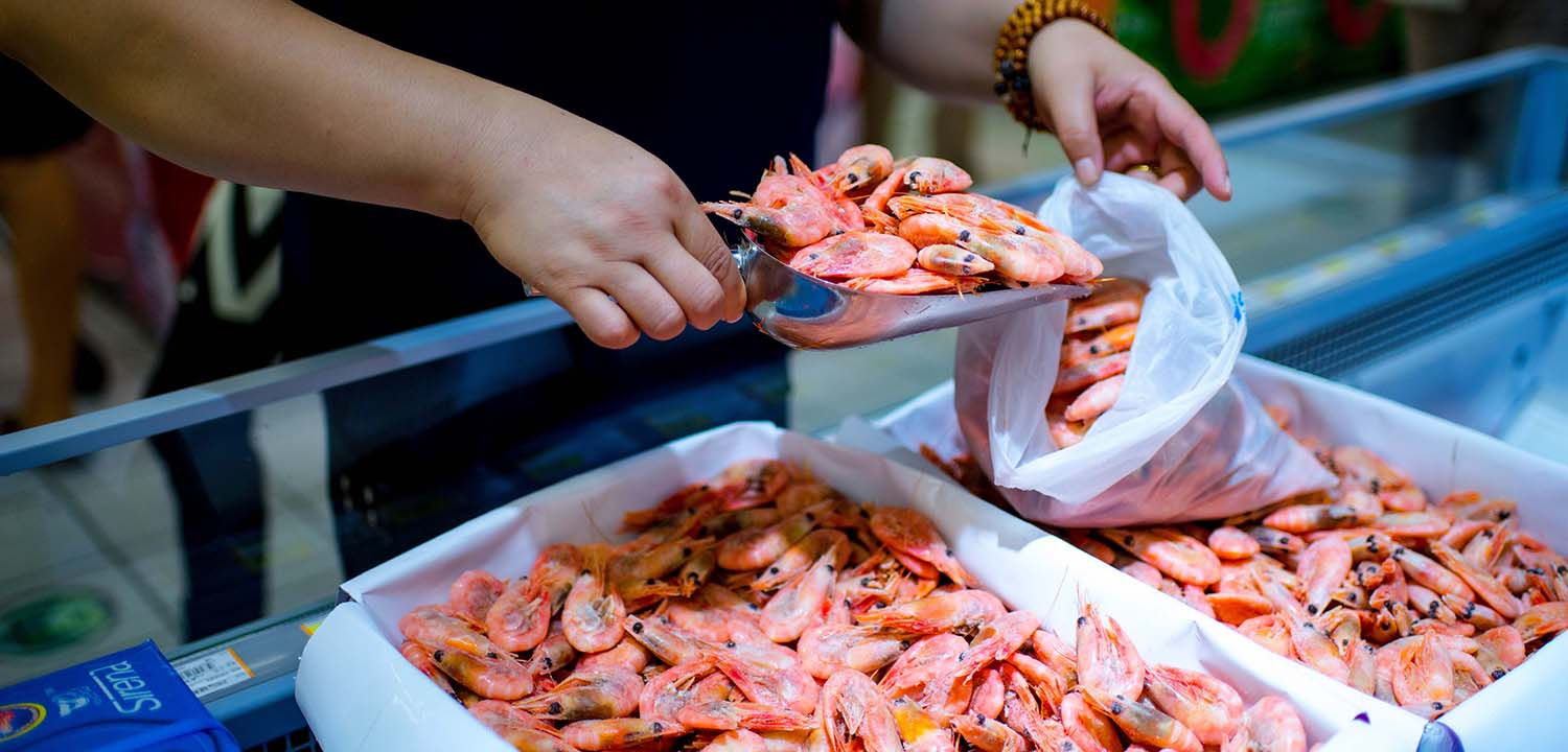 Cold water shrimp being scooped at Chinese supermarket
